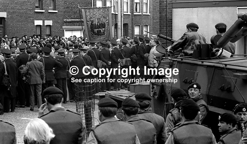 RUC and British soldiers on the Springfield Road, Belfast, N Ireland, 19th June 1971, to prevent clashes between opponents of a traditional Orange Order parade from the Loyalist Shankill Road to Whiterock Orange Hall. The parade at one stage passes along a section of the Springfield Road where the majority of residents would be of a republican viewpoint. 197106190234a<br />