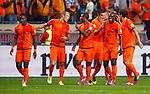 Nederland, Amsterdam, 7 september 2012.Kwalificatiewedstrijd WK 2014.Nederland-Turkije.Spelers van Nederland feliciteren Robin van Persie (4e van links) nadat hij de 1-0 heeft gescoord.
