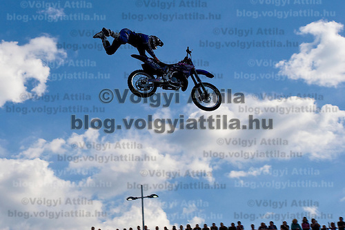 Luca Zironi from Italy performs during a freestyle motocross show organized by KTM in front of Arena Plaza, Budapest, Hungary. Thursday, 08. May 2008. ATTILA VOLGYI