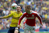 Alfie Mawson of Barnsley and Danny Hylton of Oxford United during the Johnstone's Paint Trophy Final match between Oxford United and Barnsley at Wembley Stadium, London, England on 3 April 2016. Photo by Alan  Stanford / PRiME Media Images.
