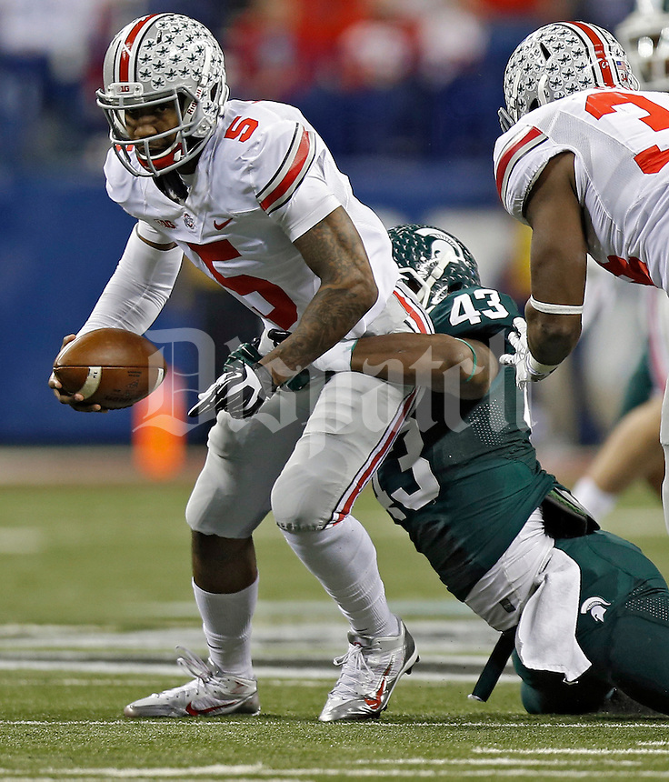 Ohio State Buckeyes quarterback Braxton Miller (5) gets sacked by Michigan State Spartans linebacker Ed Davis (43) in the 1st quarter during the Big 10 Championship game at Lucas Oil Stadium in Indianapolis, Ind on December 7, 2013.  (Dispatch photo by Kyle Robertson)