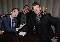 WEST HOLLYWOOD, CA - DECEMBER 13: (L-R) Panelist Ken Jeong, host Nick Cannon and panelist Robin Thicke attend the premiere karaoke event for season one of THE MASKED SINGER on Thursday, Dec.13 at The Peppermint Club in West Hollywood, California. (Photo by Scott Kirkland/FOX/PictureGroup)