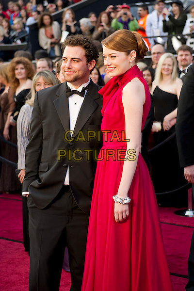 Spencer Stone and Emma Stone.Arrivals at the 84th Annual Academy Awards® in Hollywood, CA., USA..February 26, 2012.*Editorial Use Only*.oscars full length black tuxedo red sleeveless dress brother sister siblings bow half 3/4.CAP/A.M.P.A.S./NFS.©A.M.P.A.S. Supplied by Capital Pictures.