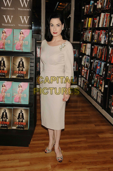 "DITA VON TEESE.At Waterstone's to sign her book ""Burlesque & The Art Of The Teese"", London, England..November 22nd, 2007.full length beige dress brooch cream snakeskin shoes .CAP/WIZ.©Wizard/Capital Pictures."