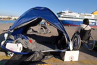 Pireus / Athens 30/3/2016<br /> Refugee camp in Pireus Port.<br /> In the picture a disabled man seriously injured during the war in Syria <br /> Photo Livio Senigalliesi