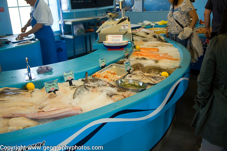 Fresh fish on sale in fishmongers, St Peter Port, Guernsey, Channel Islands, UK