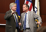 Nevada Sen. Tick Segerblom, D-Las Vegas, left, and Lt. Gov. Mark Hutchison work on the Senate floor at the Legislative Building in Carson City, Nev., on Thursday, April 9, 2015. <br /> Photo by Cathleen Allison