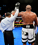HOLLYWOOD, FL - SEPTEMBER 05: Referee Sam Burgos lifts Shannon Briggs' hand in victory after he defeated Mike Marrone during the World Heavyweight Champions Fight Night at Hard Rock Live! in the Seminole Hard Rock Hotel & Casino on September 5, 2015 in Hollywood, Florida. Briggs won the bout by second round KO. ( Photo by Johnny Louis / jlnphotography.com )