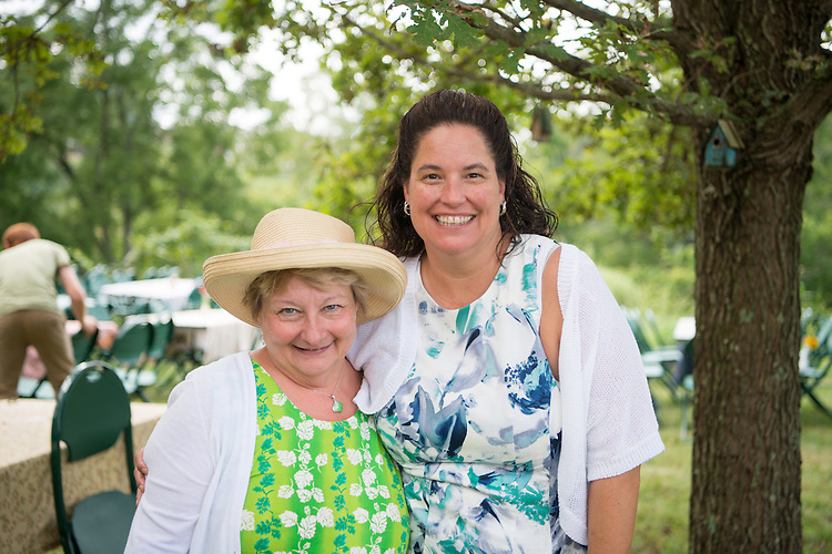 Lisa Frasure (Right), Director, Ohio University Child Development Center (CDC) stands with Cathy Waller, the recently retired director of the CDC at the annual garden party. Photo by Ben Siegel