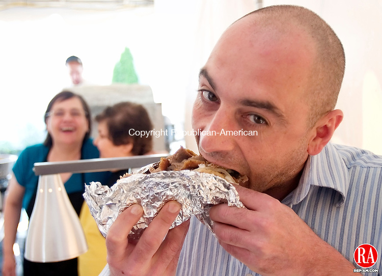 WATERBURY, CT. 06 May 2010-050610SV05--Emilio Theodoratos of Southington enjoys a Gyro at the 38th annual Greek Festival held at the Holy Trinity Greek Church in Waterbury Thursday.  Steven Valenti Republican-American