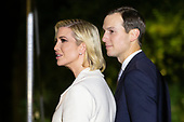 Senior Advisor to President Trump Jared Kushner (R) and his wife Ivanka Trump (L), daughter of President Trump, walk on the South Lawn after returning to the White House by Marine One, in Washington, DC, USA, 18 October 2019. The couple joined President Trump during a trip to Texas.<br /> Credit: Michael Reynolds / Pool via CNP