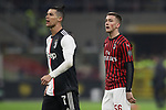 Cristiano Ronaldo of Juventus reacts as Alexis Saelemaekers of AC Milan looks on during the Coppa Italia match at Giuseppe Meazza, Milan. Picture date: 13th February 2020. Picture credit should read: Jonathan Moscrop/Sportimage