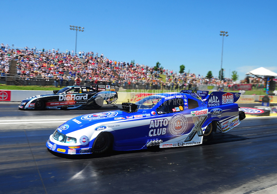 May 22, 2011; Topeka, KS, USA: NHRA funny car driver Robert Hight (near) defeats Matt Hagan during the Summer Nationals at Heartland Park Topeka. Mandatory Credit: Mark J. Rebilas-