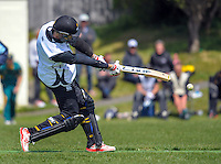 Karori's Steve Murdoch hits a boundary on his way to 257 not out during the Ewen Chatfield Trophy Wellington premier men's club cricket match between Karori and Naenae at Benburn Park, Karori, Wellington, New Zealand on Sunday, 31 October 2015. Photo: Dave Lintott / lintottphoto.co.nz