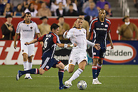 Los Angeles Galaxy midfielder David Beckham (23) and New England Revolution defender Jay Heaps (6) go for the ball. The New England Revolution and the Los Angeles Galaxy played to a 2-2 tie during an MLS regular season match at Gillette Stadium in Foxborough, MA, on August 30, 2008.