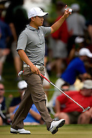 PGA golfer Anthony Kim waves to the crowd during the 2008 Wachovia Championships at Quail Hollow Country Club in Charlotte, NC.