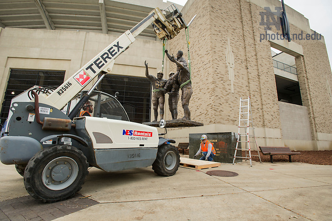 Oct. 17, 2014; The statue of former coach Ara Parseghian is removed for the Crossroads construction project at Notre Dame Stadium. (Photo by Barbara Johnston/University of Notre Dame)