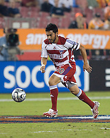 FC Dallas forward Carlos Ruiz dribbles the ball during the second leg of the Western Conference Semifinal series at Robertson Stadium in Houston, TX on November 2, 2007