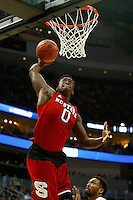 PITTSBURGH, PA - MARCH 21:  Abdul-Malik Abu #0 of the North Carolina State Wolfpack dunks against the Villanova Wildcats in the second half during the third round of the 2015 NCAA Men's Basketball Tournament at Consol Energy Center on March 21, 2015 in Pittsburgh, Pennsylvania.  (Photo by Jared Wickerham/Getty Images)