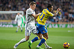 Toni Kroos of Real Madrid competes for the ball with Jonathan Viera of UD Las Palmas during the match of Spanish La Liga between Real Madrid and UD Las Palmas at  Santiago Bernabeu Stadium in Madrid, Spain. March 01, 2017. (ALTERPHOTOS / Rodrigo Jimenez)