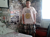 Pictured: Scott Bryant in his bedroom which is covered with Swansea related items and and pictures, image taken from open facebook account.<br />