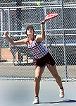 NAUGATUCK CT. 17 April 2019-041719SV11-Sabrah Cegielski of Naugatuck serves to Ava Longo of Sacred Heart during tennis action in Naugatuck Wednesday.<br /> Steven Valenti Republican-American