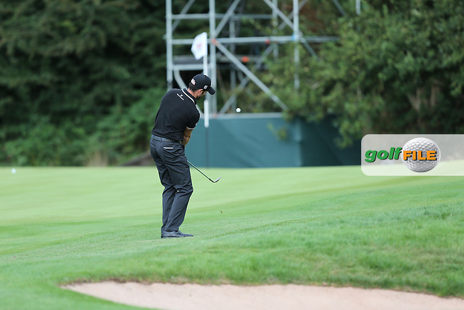 Gregory Bourdy (FRA) with chip to the 9th during Round One at the 2013 ISPS Handa Wales Open from the Celtic Manor Resort, Newport, Wales. Picture:  David Lloyd / www.golffile.ie