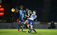Luke O'Nien of Wycombe Wanderers beats Francois Zoko of Yeovil Town to the ball during the Sky Bet League 2 match between Wycombe Wanderers and Yeovil Town at Adams Park, High Wycombe, England on 14 January 2017. Photo by Andy Rowland / PRiME Media Images.