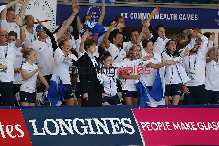 Glasgow 2014 Commonwealth Games<br /> Scottish team mates of Hannah Miley show their support as she swims to gold in the Women's 400m Individual Medley.<br /> Tollcross Swimming Centre<br /> <br /> 24.07.14<br /> ©Steve Pope-SPORTINGWALES