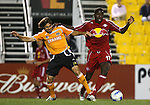 31 March 2007: Houston's Brian Mullan (l) and New York's Jozy Altidore (17) challenge for the ball.  Major League Soccer's Houston Dynamo defeated the New York Red Bulls 2-1 in a preseason game at Blackbaud Stadium on Daniel Island in Charleston, SC, as part of the Carolina Challenge Cup.