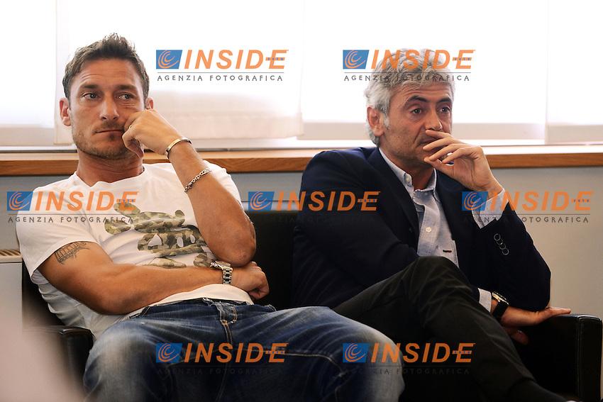 Francesco Totti e Franco Baldini durante la conferenza stampa di Addio di Luis Enrique.Roma 12/05/2012 Centro Sportivo Trigoria.Football Calcio 2011/2012 Serie A.Conferenza Stampa.Foto Insidefoto Andrea Staccioli