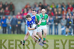 Keith Sheehan Laune Rangers is tackled by Ian Twiss Milltown Castlemaine during the Mid Kerry final in Beaufort on Saturday