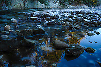 Reflections on Second Pond Brook in early winter in the Adirondack Mountais in New York State