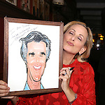 Marlee Matlin, posing with a portrait of Henry Winkler, attends the Marlee Matlin Sardi's Portrait unveiling at Sardi's Restaurant on November 24, 2015 in New York City.