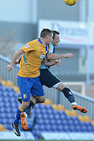 Mansfield Town's Lee Collins and Wycombe Wanderers Garry Thompson battle for an aerial ball during the Sky Bet League 2 match between Mansfield Town and Wycombe Wanderers at the One Call Stadium, Mansfield, England on 31 October 2015. Photo by Garry Griffiths.