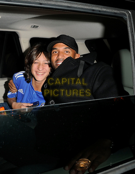 GUEST & CRAIG DAVID.Spotted being driven through Piccadilly Circus, London, England, UK, .October 4th 2009..half length in car cab taxi shot black cap hat blue adidas sports top arm around shoulder .CAP/CAN.©Can Nguyen/Capital Pictures