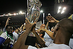 08 August 2012: Kansas City's Julio Cesar (BRA) (right) holds the championship trophy up so that fans can touch it as Kei Kamara (SLE) (left) and Aurelien Collin (FRA) (behind) watch. Sporting Kansas City won the championship over Seattle Sounders FC 3-2 on penalties after the game ended in a 1-1 tie at Livestrong Sporting Park in Kansas City, Kansas in the 2012 Lamar Hunt U.S. Open Cup Final.