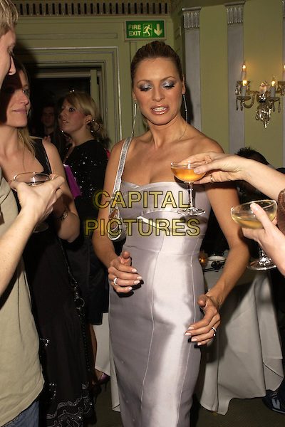 TESS DALY.Inside Arrivals at the New Woman Beauty Awards 2006, The Dorchester Hotel, London, England, April 11th 2006..half length strapless grey silver white dress daley drink glass funny.Ref: CAN.www.capitalpictures.com.sales@capitalpictures.com.©Can Nguyen/Capital Pictures