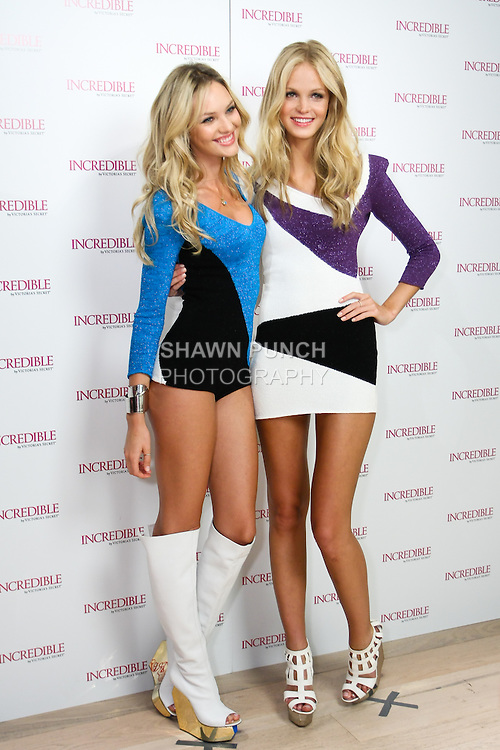 """Candice Swanepoel and Erin Heatherton pose together during the """"Incredible by Victoria's Secret"""" launch at the Victoria Secret SOHO Store, August 10, 2010."""