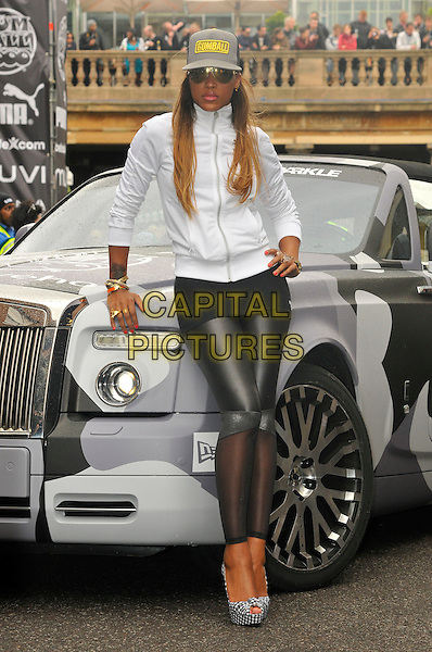 EVE (Eve Jihan Jeffers).The start of Gumball 3000, Covent Garden, London, England. .May 26th, 2011.full length black leather sheer leggings white top baseball cap hat sunglasses shades platform shoes pep toe hand on hip car.CAP/CAS.©Bob Cass/Capital Pictures.