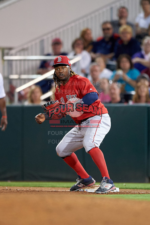 Boston Red Sox first baseman Hanley Ramirez (13) waits for a throw during a Spring Training game against the Minnesota Twins on March 16, 2016 at Hammond Stadium in Fort Myers, Florida.  Minnesota defeated Boston 9-4.  (Mike Janes/Four Seam Images)