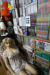 July 5, 2010 - Tokyo Japan - A Love Doll is pictured in a room with a library of video tapes in Tokyo, Japan, on July 5, 2010. The owner of the doll is Ta-bo, a 50-year-old engineer who is a Love Doll collector and rents a special three-bedroom apartment for his sex dolls. Ta-bo says he owns more than one hundred dolls, which, to his mind, is the world's largest collection of its kind.