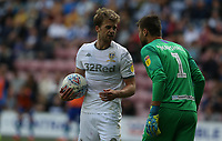 Leeds United's Patrick Bamford in conversation with Wigan Athletic's David Marshall<br /> <br /> Photographer Stephen White/CameraSport<br /> <br /> The EFL Sky Bet Championship - Wigan Athletic v Leeds United - Saturday 17th August 2019 - DW Stadium - Wigan<br /> <br /> World Copyright © 2019 CameraSport. All rights reserved. 43 Linden Ave. Countesthorpe. Leicester. England. LE8 5PG - Tel: +44 (0) 116 277 4147 - admin@camerasport.com - www.camerasport.com