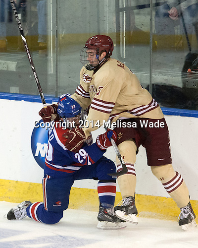 Derek Arnold (UML - 29), Ian McCoshen (BC - 3) - The Boston College Eagles defeated the University of Massachusetts Lowell River Hawks 4-3 in the NCAA Northeast Regional final on Sunday, March 30, 2014, at the DCU Center in Worcester, Massachusetts.