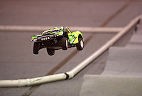 NWA Democrat-Gazette/BEN GOFF @NWABENGOFF<br /> Electric radio control cars race around the off road short course on Sunday Nov. 29, 2015 at NWA R/C Raceway in Rogers. The shop holds races most weekends for a variety of types of 1/10-scale electric vehicles on two indoor tracks.