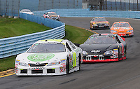Aug. 8, 2009; Watkins Glen, NY, USA; NASCAR Nationwide Series driver Justin Marks (10) leads J.R. Fitzpatrick (4) during the Zippo 200 at Watkins Glen International. Mandatory Credit: Mark J. Rebilas-