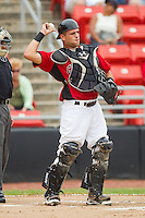 Catcher Vinny DiFazio #23 of the Hickory Crawdads throws the ball back to his pitcher at  L.P. Frans Stadium August 1, 2010, in Hickory, North Carolina.  Photo by Brian Westerholt / Four Seam Images