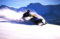 A snowmobile in the mountains.