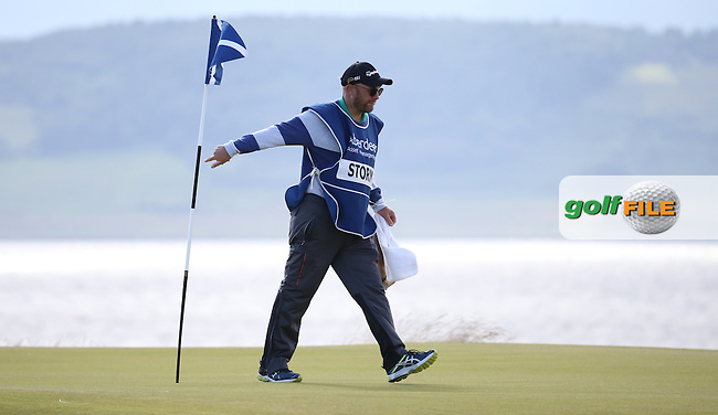 Caddie Gary leaving the 6th green during Round One of the 2016 Aberdeen Asset Management Scottish Open, played at Castle Stuart Golf Club, Inverness, Scotland. 07/07/2016. Picture: David Lloyd | Golffile.<br /> <br /> All photos usage must carry mandatory copyright credit (&copy; Golffile | David Lloyd)