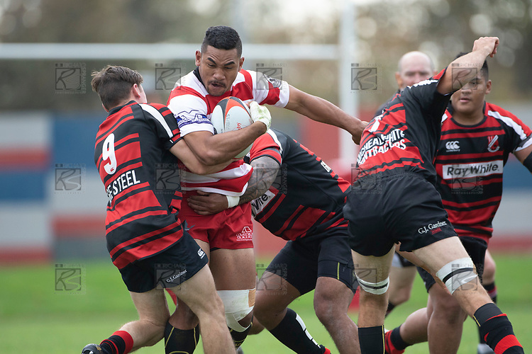 Rodney Tongotea has his run stopped by Jamie Harford and Setulu Punatai. Counties Manukau Premier Club Rugby game between Papakura and Karaka played at Massey Park Papakura on Saturday May 5th 2018. Papakuar won the game 28 - 25 after trailing 6 - 12 at halftime.<br /> Papakura - Faalae Peni, Darryl Hemopo, George Crichton, Federick Cain tries, Faalae Peni conversion; Faalae Peni 2 penalties, Karaka -Salesitangi Savelio, Cardiff Vaega, Walter Fifita tries, Juan Benadie 2 conversions, Juan Benadie 2 penalties.<br /> Photo by Richard Spranger.